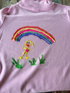 Grand daughter number one Miss Belle's hand painted skivvy, 'self portrait with rainbow'