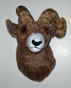 "Plush Big Horn Sheep Head ""Cliff"" Large Shoulder Mount. Social by nature, bighorn sheep are gregarious animals that love to play and forage together, often in herds of 100 or more! Cliff is the lone bighorn in our Fairgame family, but fortunately he enjoys being around the other mounts. He is confidently posed looking just to his left. His long curled horns are fully adjustable. PRODUCT SPECS: Depth is 18"" nose to wall. 14""w x 20""h. Girth at shoulder is 33"". Horn span is 16"". Cliff is a…"