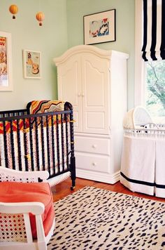 jenny lind crib in black, black and white stripe window treatment (mixes dark crib with white furniture)