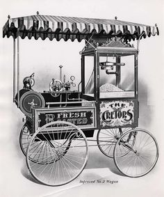 An early popcorn machine in a street cart, invented in the 1880s by Charles Cretors in Chicago.