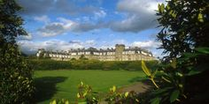 Looking across the bowling green to The Gleneagles Hotel in Scotland.   Free upgrade at booking, complimentary afternoon tea for two and a round of golf on the King's or Queen's Course when booking through The Luxury Travel Group. Contact Info@theluxurytravelgroup.com for availability and details of our Virtuoso benefits.   Benefits based on a 2-night stay.   1-404-869-7412 [International]  1-800-863-9067 [United States]  The Luxury Travel Group
