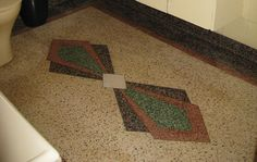 The existing terrazzo floor with art deco pattern provides inspiration