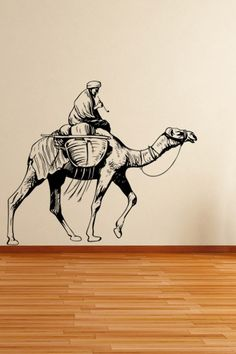 Desert Camel Wall Sticker. The vivid illustration of four intrepid came led by bold men on the sand of deserts brings in an unruffled and soothing aura into the wall decors of your living rooms. http://walliv.com/desert-camel-wall-sticker-wall-decal