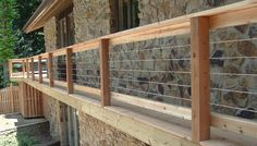 Stainless Steel Cable Deck Railing Systems View plenty Deck Railing Ideas http://awoodrailing.com/2014/11/16/100s-of-deck-railing-ideas-designs/