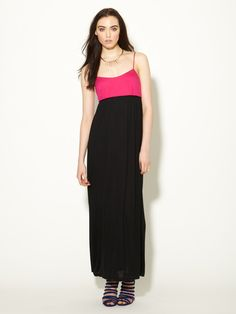 Two-tone maxi dress in NEON pink and black. By Miguelina.