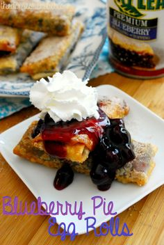 Blueberry Pie Egg Rolls! These egg rolls are stuffed with fresh blueberry pie filling and white chocolate, then fried until golden and dusted with cinnamon and sugar. Absolutely divine!