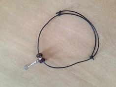 Collier cuir noeud coulissant
