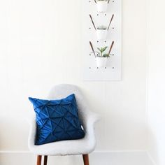 DIY your own modern pegboard out of some plywood and create this chic, modern planter!
