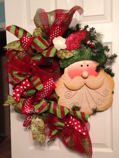 Deco mesh funky bow wreath with huge metal Santa $45