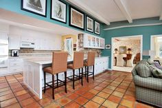 The kitchen and family room feature terra cotta tile flooring at 17 Burr Farms Road. Photo: Contributed Photo / Westport News