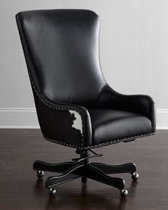 I so want this.     Dougherty Hairhide Executive Office Chair at Horchow.