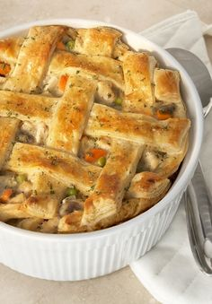 """The Ultimate Chicken Pot Pie — This recipe earns its """"ultimate"""" credentials from the light and flaky puff pastry crust, which perfectly pairs with the creamy mixture of chicken broth, flour, carrots, onions, and mushrooms. It's delicious!"""