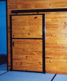 This is a full wood sliding door with black powder coat finish! Check out what we can customize for you! www.classic-equine.com #CEE #classicequine #besthorsestalls