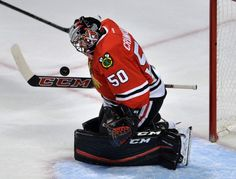 Chicago Blackhawks goalie Corey Crawford makes a save during the first  period of an NHL hockey game against the Columbus Blue Jackets Saturday 4f8d7ae5e