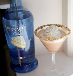 2 tablespoons Pinnacle Cake Flavored Vodka  1 tablespoon Godiva Original Chocolate Liqueur  1 tablespoon Baileys Creme Caramel Liqueur  4 tablespoons milk (or cream)  1 teaspoon JELL-O turtle flavored instant pudding mix  Caramel  Finely crushed toasted pecans  Whipped Cream (optional)