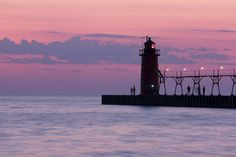 The lighthouse at South Haven, Michigan.  A beautiful place to see the lake. been there. this is one of my favorite places