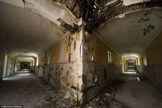 Behind the locked doors of an abandoned asylum: Dilapidated hospitals that were home to a 'community' of 2,000 mentally ill patients over 50 years ago and are still waiting to be demolished