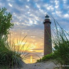 Lovely lighthouse at sunset in the sand dunes painting inspiration.
