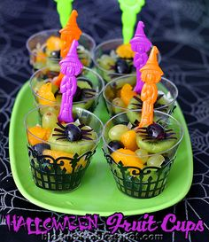 Halloween Fruit Cups - like how they used cupcake wrappers around plastic cups!