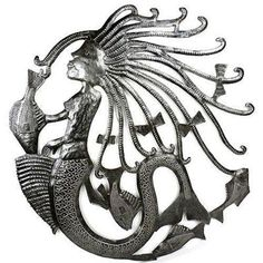 24-inch Mermaid Oil Drum Wall Art Handmade and Fair Trade. Hand-cut and embossed from steel drums by Haitian artisans, this 24 inch piece of wall art features a mermaid. Made from 55 gallon oil drums in Haiti.