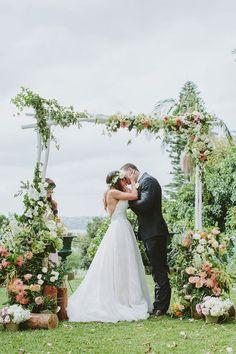 floral ceremony arch - photo by I Love Wednesdays http://ruffledblog.com/best-of-2015-wedding-ceremonies