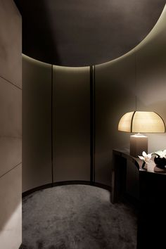 Simple shapes with accent lighting at the ceiling