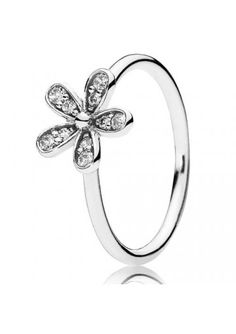 22ac914ee Carefully crafted daisy ring in sterling silver with bead-set cubic zirconia  stones. Capture the innocent beauty of the daisy and wear alone or stacked.