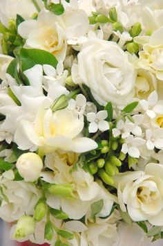 White.   Double Lysianthus, Gardenias & Stephanotis tied with Navy Ribbon.    For Zoe, wedding planning & design by Cardeia Weddings, http://www.cardeiaweddings.com/zoe-paul-wedding-in-paros.php