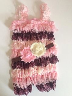 a flower headband with a rhinestone center to match the lace petti romper. This romper is a light pink, ivory and chocolate brown. All the rompers