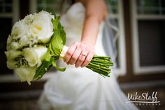 Bride shows off her round cut diamond wedding ring and white rose bouquet #Michiganwedding #Chicagowedding #MikeStaffProductions #wedding #reception #weddingphotography #weddingdj #weddingvideography #wedding #photos #wedding #pictures #ideas #planning #DJ #photography #rings #engagementring