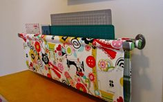 Quilting Ruler Sling...could go on the side of the cutting table.  Fun Fabrication: Handmade Craft Room Storage