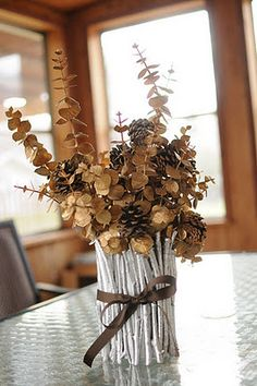 change this up easy just by changing the foliage and ribbon and you have an all year round centerpiece thats easy to keep updated! :)