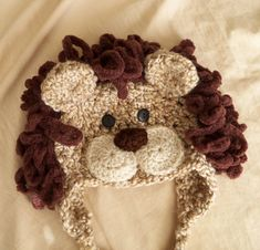 Crochet Lion Earflap Hat.  Didn't use a pattern, but looks a lot like this, but I'm sure my mane is done differently.