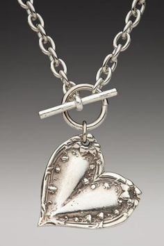 Silver Spoon Jewelry: Vintage Spoon and Fork Jewelry: Lila spoon necklace.  Love the lily of the valley!