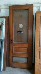 """Gorgeous quarter-sawn """"tiger"""" Oak doors from the United States federal courthouse downtown Tampa circa 1905. Nearly 60 new doors available!   Half of the doors have beautiful privacy glass with original lettering.  The majority of the doors are either 7′ or 8′ tall by 36 inches wide.  Very high quality old world craftsmanship seldom seen anymore today."""
