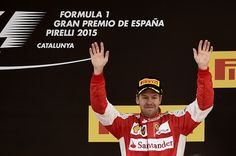Ferrari's German driver Sebastian Vettel  celebrates on the podium after the Spanish Formula One Grand Prix on May 10, 2015 at the Circuit de Catalunya in Montmelo on the outskirts of Barcelona