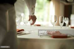 Stock Photo : Man arranging glasses on table