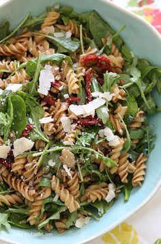 Summer Pasta Salad with Baby Greens – I love making this mayo-less pasta salad with a good does of greens, sun dried tomatoes, capers, fresh shaved Parmesan cheese and a splash of balsamic and oil.  #cleaneats