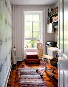 What to do with that third small bedroom--office, wallpaper, vintage suitcases.