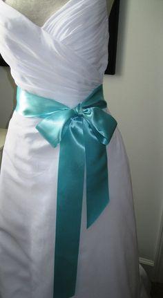 Love the idea of a Tiffany blue sash on a wedding dress!