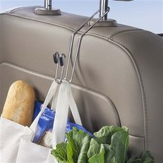 A 2-pack of these CarHooks turns a seat back into instant car storage and organization space! Keep groceries, shopping bags, purses, hats and jackets off the floor for clean, contained storage.
