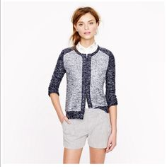 J Crew Boucle Jacket in Indigo Colorblock The look of tweedy, tailored bouclé meets the plush softness of a knit with this jacket. Crafted in an ultra-flattering, structured yet stretchy two-in-one fabric designed just for us, it's a design team favorite for its chic colorblock (made in two rich shades of indigo) and its sleek zip front. J. Crew Sweaters