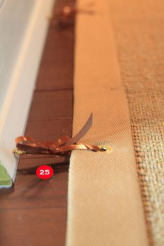 "25. Moss uses ""not quite wall-to-wall carpeting"" with the addition of grommets."