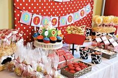Dessert Table:  I used a red and white polka dot fabric for the backdrop and hung the Happy Birthday banner over the fabric. I created two barn silos – using sonar tubes from my local hardware store – by spray painting them red and using strips of stock card to create the tops.  The center of the table was placed with a wooden wheelbarrow filled with animal crackers, and I used hay barrels for each side of the table to display swirly lollipops and marshmallow pops in the other. Also on the…
