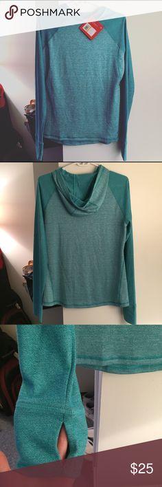 Fila mint blue thumb hole running sweater Has hood. Nwt. Small but runs big can fit medium. Has thumb holes. Fila Tops Sweatshirts & Hoodies