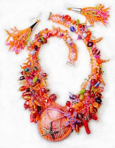 "Orange clamshell ""gorgeous goddess"" necklace with earrings"