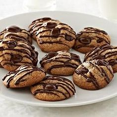 Recipe: Cinnamon Chocolate Chip Cookies from Ghirardelli // Loaded with cacao bittersweet chocolate chips, these cinnamon cookies drizzled with even more chocolate are perfect with coffee, tea, or a frosty glass of milk. — Ghirardelli