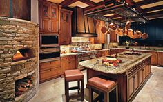 Love the wood fireplace in the kitchen for making pizza and what not. So cozy, I'd live there