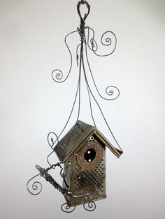 Dilapidated Delight Unique Rusty Cheese Grater Birdhouse.  via Etsy.