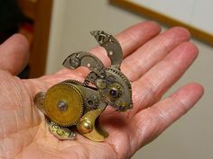 Clock parts can be used to make things other than clocks or clutter. Susan Beatrice of All Natural Arts uses those parts to make tiny steampunk sculptures.